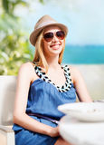 Girl in shades in cafe on the beach Stock Image