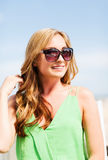 Girl in shades in cafe on the beach Stock Photography