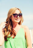 Girl in shades in cafe on the beach. Summer holidays and vacation - girl in shades in cafe on the beach Stock Photos