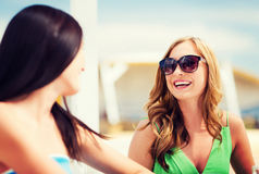 Girl in shades in cafe on the beach Royalty Free Stock Photos