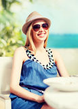 Girl in shades in cafe on the beach Stock Photo