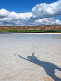 Girl shadow on a salt lake Royalty Free Stock Images