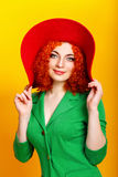 Girl in shady hat Stock Photography