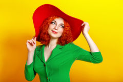 Girl in shady hat Stock Images
