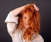 Girl with shaggy red hair, portrait. Face stock images