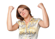 Girl shakes the fists lifted upwards Stock Photos
