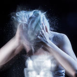 Girl shakes  lot of dandruff from head, grotesque Stock Photo