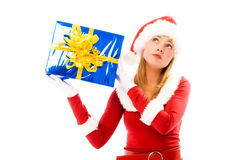 Girl shaking a box with a Christmas present Royalty Free Stock Image