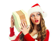Girl shaking a Christmas present Stock Photo