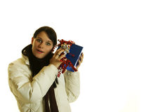 Girl shaking a gift Stock Photo