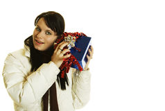 Girl shaking a gift Royalty Free Stock Photo