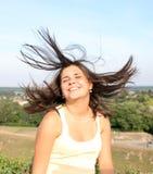 Girl shaking her head. Beautiful cute smileing female having fun outdoor Royalty Free Stock Image