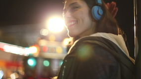 Girl shaking her head to the rhythm of music with headphones stock footage