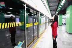 Girl at shanghai subway station. Girl waiting for train in shanghai HongMei road Station Stock Photos