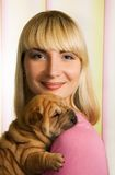 Girl with shar pei puppy Stock Image