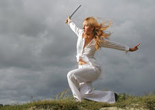 The girl with a sharp sword Stock Photo