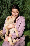 Girl with a sharpei. Young girl hugs a sharpei puppy Royalty Free Stock Photos