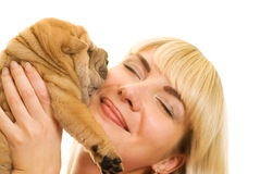 Girl with sharpei puppy Royalty Free Stock Photos