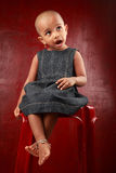 Girl with shaved head. Little girl with shaved head shows the expression of surprise Stock Photos