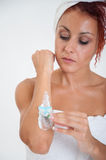 Girl shaving her arm Stock Photography