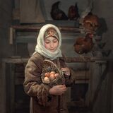 A girl in a shawl with a basket of eggs