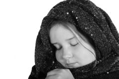 Girl in shawl and eyes closed Royalty Free Stock Photo