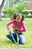 Girl with shears gardener Royalty Free Stock Image