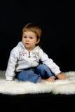 Girl on sheepskin Royalty Free Stock Images