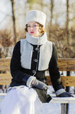 Girl in sheepskin coat and fur hat Royalty Free Stock Photography