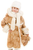 Girl in a sheepskin coat and hat Stock Images