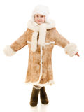 Girl in a sheepskin coat and hat Royalty Free Stock Photos
