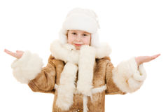 Girl in a sheepskin coat and hat. With an open palm on a white background Stock Image