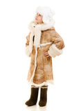 Girl in a sheepskin coat and hat looking up Royalty Free Stock Image