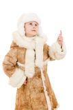 Girl in a sheepskin coat and hat looking up Royalty Free Stock Photo