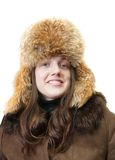 Girl in sheepskin and hat with earflaps Stock Photos