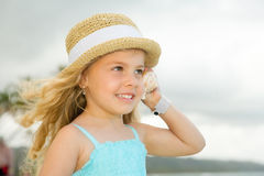 Girl with a shell Royalty Free Stock Image