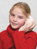 Girl and shell Stock Photos