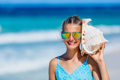 Girl with shell at the beach Royalty Free Stock Images