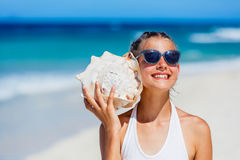 Girl with shell at the beach Royalty Free Stock Photography