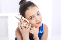 Girl with shell Stock Photo