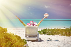 Girl with a shell on the sunbed looking to the ocean Royalty Free Stock Image