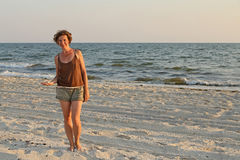 Girl with shells Stock Images