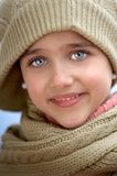 Girl sheltered for the cold Stock Photo