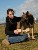 Girl and shepherd. Young woman and her friend belgian shepherd Stock Photos