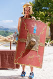 Girl with shield and helmet Royalty Free Stock Photography