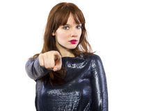Girl in Shiny Dress Pointing Royalty Free Stock Photos