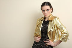 Girl in a shiny leather jacket Royalty Free Stock Photography