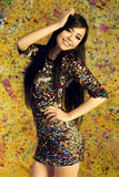 Girl in shiny party dress Stock Image