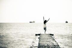 Girl ships at sea on the horizon Stock Photos