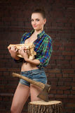 Girl in shirt chopping wood with an ax Royalty Free Stock Images